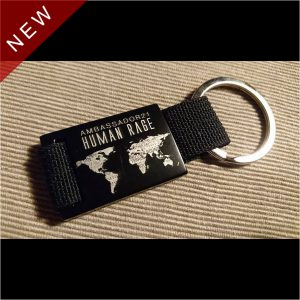 """Metal keychain """"Human Rage / Fuck All Systems"""" 25 copies limited edition. Double sided laser engraving, aluminium / polyester, numbered by laser."""
